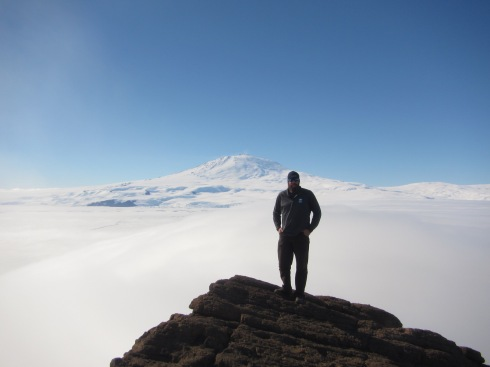 Atop the rock.  Mt Erebus in the background