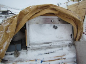 This is what an Antarctic Winter will do to equipment left outside.  These are our high pressure pump sleds that were covered with tarps.  Snow finds its way through regardless of the tiniest of holes.