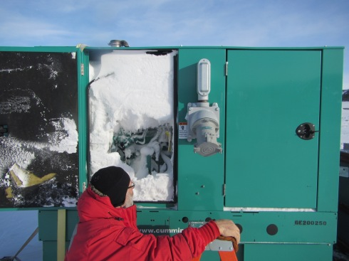Our 50 KW generator that powers the drill camp didn't fair so well over the winter.  Its is entirely filled with densely packed snow.  Today, we had it picked off the traversable sled and moved up into a warm building to melt.